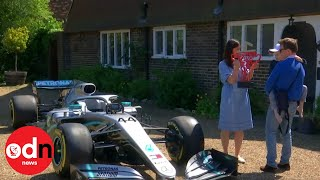 Lewis Hamilton gifts winning Formula One car and trophy to young terminally ill boy
