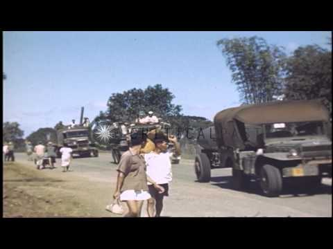 Natives walking on a highway after the invasion of Manila, Philippines by Allied ...HD Stock Footage