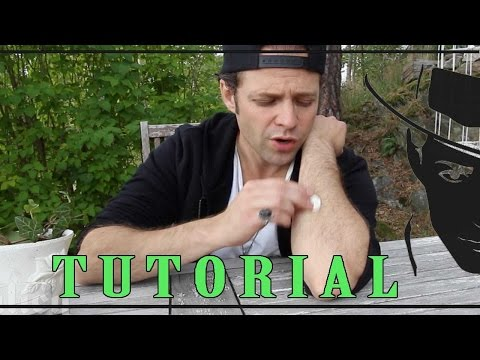 How To Rub A Coin Into Your Arm Magic Trick Tutorial -Julien Magic