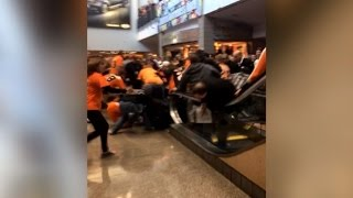 Hockey Fans Fly Off Broken Escalator, But It Happens More Than You Think