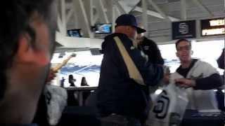 Luigi confronts San Diego Padres Catcher Jon Baker