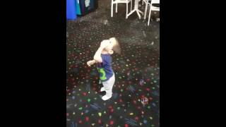 Baby catching bubbles