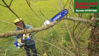 In action the HYMT5080 Petrol Multi-Tool - Hedge Trimmer / Brush Cutter / Chainsaw from Hyundai
