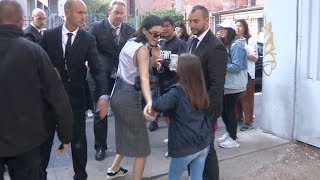 Kendall Jenner pose for a selfie with a young fan after the Bottega Veneta Show in Milan