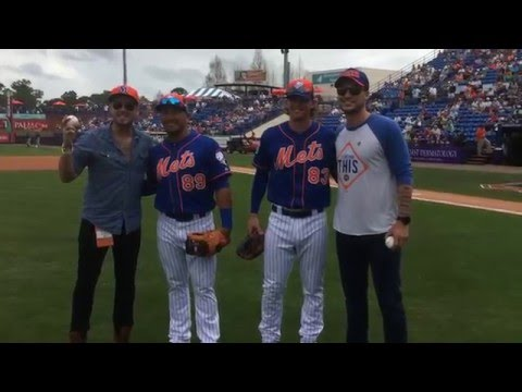 Love and Theft Throw Out the First Pitch at the Astros v Mets Spring Training Game