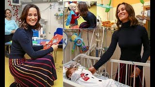 Pippa Middleton looked style in a striped skirt at the British Royal Hospital 2017