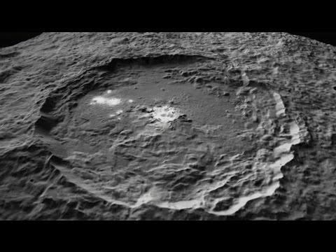 nasas dawn spacecraft flight over occator crater on