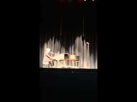 """Rafael performing """"Goshen"""" by Beirut."""