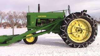 1954 Model 70 John Deere gasoline tractor with snow plow.