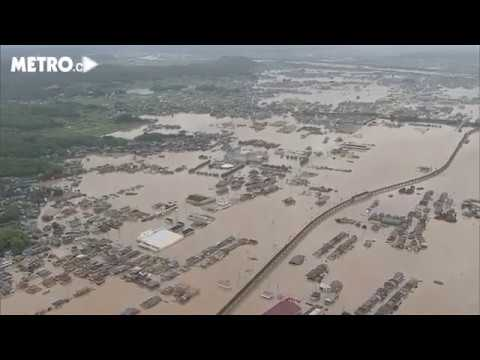 Elderly couple airlifted to safety as Japan flood rescue mission declared 'race against the clock