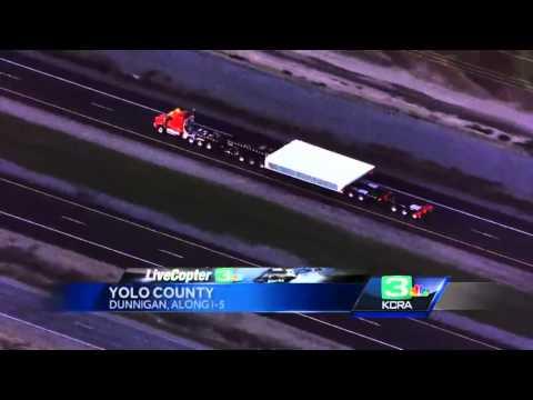 Large floodgate for Folsom Dam travels down interstate 5