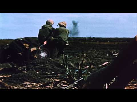 Marine infantrymen stringing communication lines as tanks advance  on the battlef...HD Stock Footage
