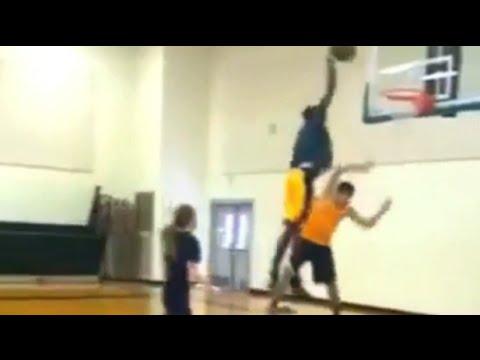 Jeremy Evans destroys kid with slam dunk!