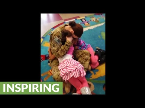 Deployed mom surprises twin daughters at school