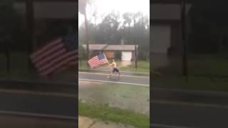 Lane pittman headbanging to slayer - raining blood while holding giant american flag