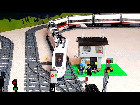 Thumbnail: Long train arriving and leaving Lego City railway station