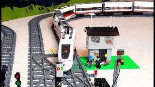 Long train arriving and leaving Lego City railway station