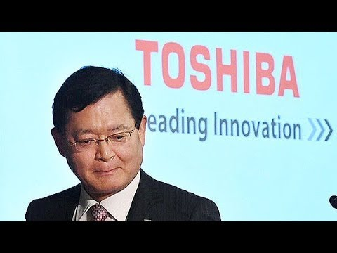 Toshiba rebounds to record net profit and saves stock listing