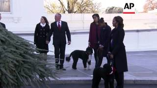 First Lady Michelle Obama, her daughters Malia and Sasha, and their two dogs Bo and Sunny greeted th