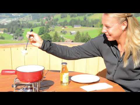 Pro Tennis Player, Anett Kontaveit, experiences fondue in the Swiss Alps