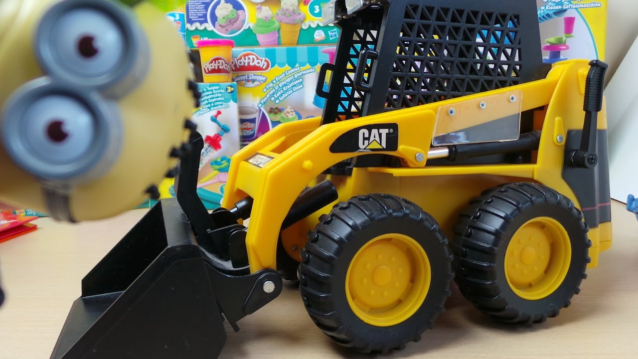 Minions Playiong With The Toy State Caterpillar Bobcat