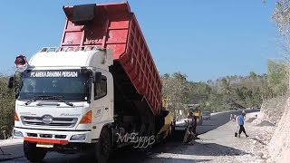 Hino FM260Ti Dump Truck Loading Asphalt Paver