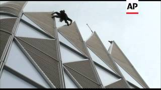 Climber scales First Tower, country's highest skyscraper
