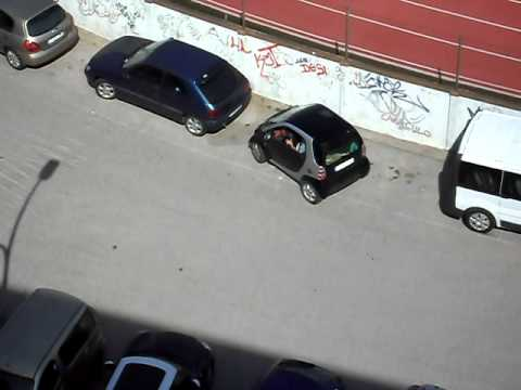 spanish woman is parking her SMART car  :-D