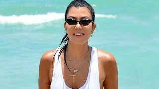 Video Kourtney Kardashian Shows Lots of Skin in Sexy White Swimsuit in Miami download MP3, 3GP, MP4, WEBM, AVI, FLV Maret 2018