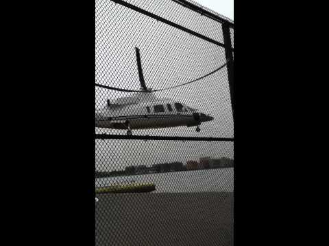 Executive charter Helicopter hovers over Limousine in New York City: Executive Travel Limousines