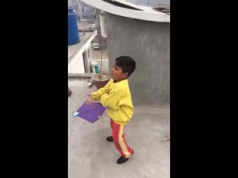 Crazy Indian kid flying his kite - bad language (Punjabi audio)