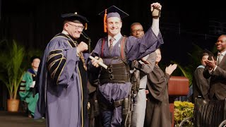 College Graduate Uses Exoskeleton to Walk Across Stage and Accept His Diploma