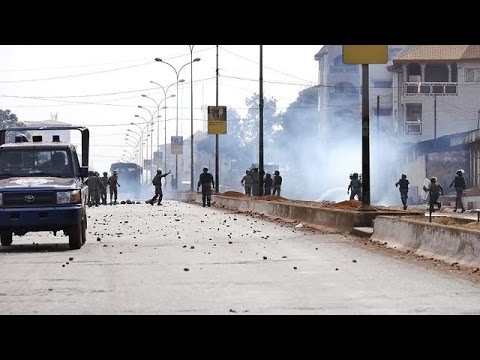 Anti-government protesters in Guinea clash with police