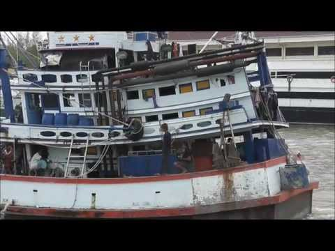 Fishing trawlers coming out of harbour for work. South Phuket, Thailand