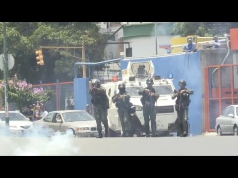 Venezuelan police fire tear gas at anti-Maduro protesters