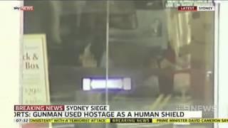 Sydney Siege: Gunman Uses Hostage As Human Shield