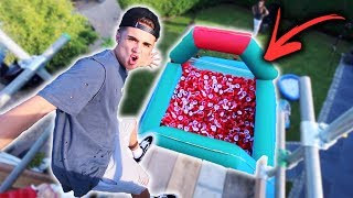 BOUNCY HOUSE FILLED WITH 10,000 RED CUPS