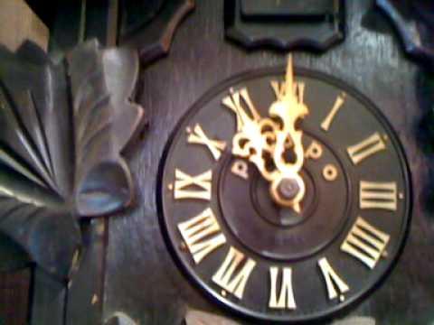 tezuka poppo clock with an owl