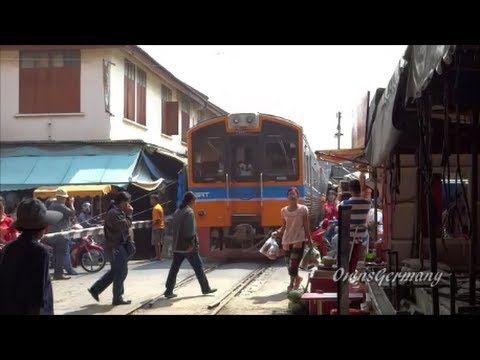Maeklong Railway Market - Train Runs Through Open Air Market in Thailand