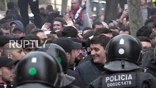 Spain: Olympique Lyon fans storm Barca for UCL second leg