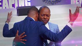 Prophet JOEL FRANCIS TATU receives an impartation from his spiritual father Pastor ALPH LUKAU
