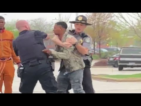 Caught on camera, officer punches suspect