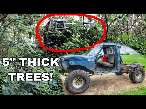 Big Block F350 On 40s plows through dense forest swamp