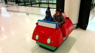 Ayush driving a car with Maanya