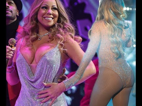 Braless Mariah Carey stuns as cleavage ERUPTS from plunging dress
