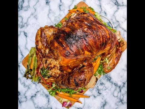 Bacon Wrapped Roast Turkey with Fruits and Rice Stuffing
