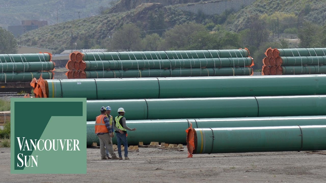 Trains laden with pipes for the Trans Mountain expansion have been