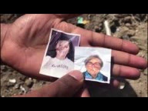 People sift through debris at Ethiopia crash site