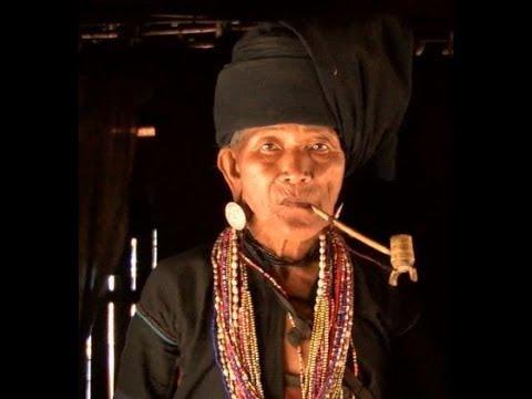 Myanmar  [ Burma  ]  Akhu Hill tribes Woman smoke pipe
