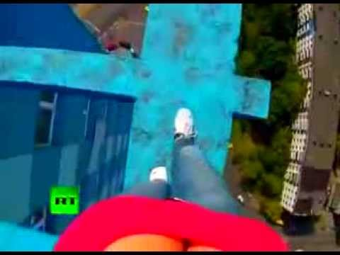 Brazil Lady walks on top of a high rise building without safety Harnesses,